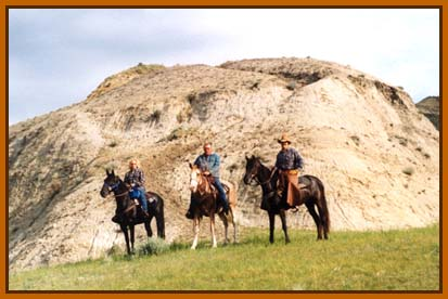 The horse and rider on the left is Duster and me.  See North Dakota isn't all flat!